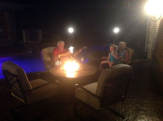 john jordan - with family around pool and firepit